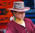 Latina woman with hat and bright sweater